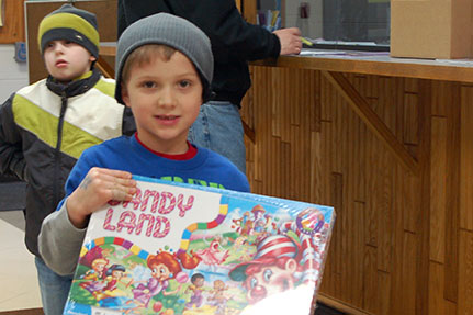 Little Boy With Candy Land Board Game
