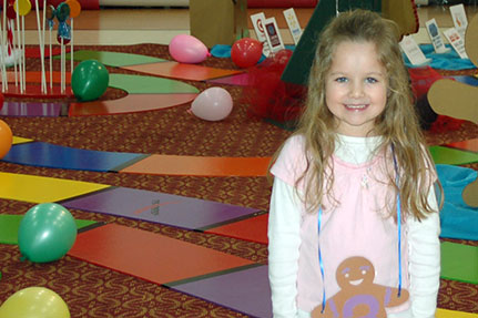 Little Girl Posing for Picture in Candy Land