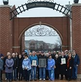 Arched gateway dedication ceremony